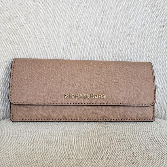 Michael Kors Handbags - SOLD 🌺NWT Michael Kors Travel Flat Wallet Khaki